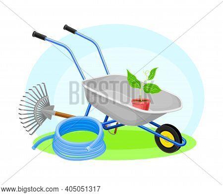 Garden Tools And Equipment With Wheelbarrow, Rake And Hose Vector Composition