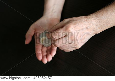 Elderly Woman Counts A Coins, Wrinkled Female Hands With Metal Money Closeup. Concept Of Poverty, Pe