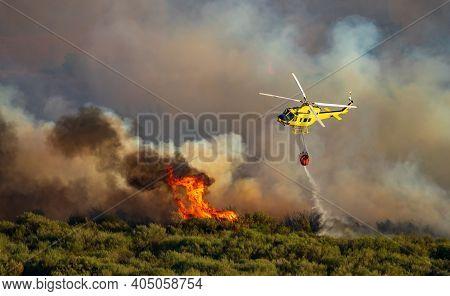 Smoke And Huge Fire, Helicopter With Bambi Bucket