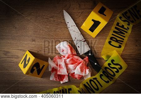 Flat Lay Composition With Evidences And Crime Scene Markers On Wooden Background