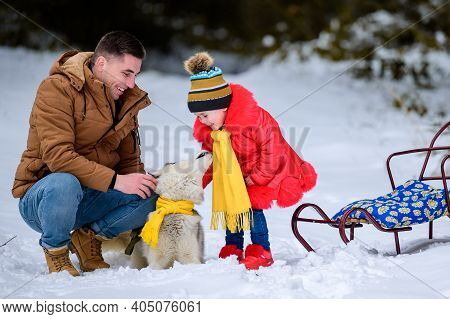 Happy Father With Daughter On A Walk In The Woods, Girl And Husky In Yellow Scarves, Bright Clothes