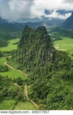 Lush And Green Craggy Mountain View Of Vang Vieng Laos During The Rainy Season.