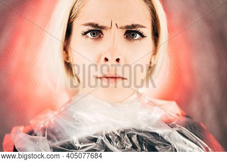 Anxious Woman. Art Portrait. Plastic Pollution. Waste Recycling. Save Planet. Strict Lady Strangled