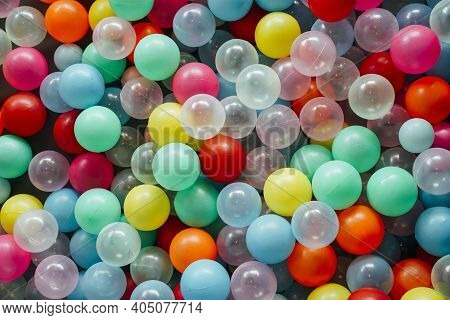Close-up View Of Colorful Array Of Toy Plastic Balls In A Ball Pit.