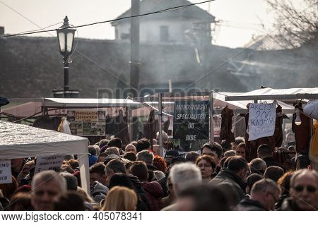 Kacarevo, Serbia - February 16, 2019: Crowd Of People In A Packed Alley Of The Kobasicijada, A Tradi