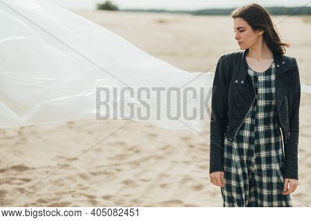 Fashion Portrait. Autumn Melancholy. Nostalgia Hope. Pensive Woman Daydreaming Standing Alone In Col