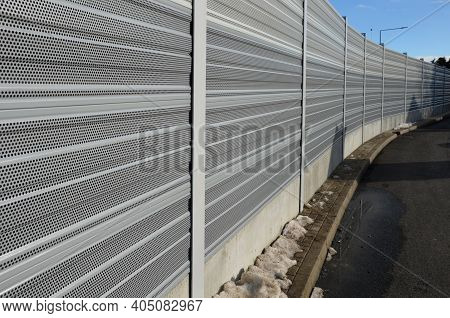 Noise Barrier Made Of Metal Perforated Sheet Metal Slats. Gray And Silver Protective Fencing Separat