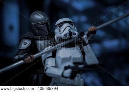 JAN 25 2021: Disney Plus series Star Wars The Mandalorian Din Djarin fighting a Stormtrooper with a beskar spear  - Hasbro action figure