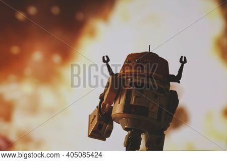 JAN 25 2021: Star Wars Rebels astromech C1-10P droid Chopper escaping an explosion  - Hasbro action figure