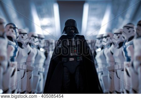 JAN 25 2021: Star Wars Sith Lord Darth Vader exits shuttle with row of Imperial Stormtroopers  - Hasbro action figure