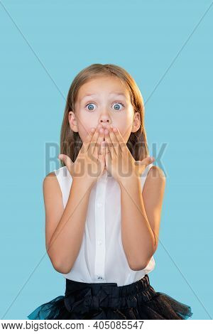 Shocked Kid. Back To School. Unexpected News. Portrait Of Surprised Overwhelmed Cute Little Girl In