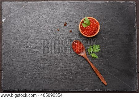 Fresh Grainy Red Chum Salmon Caviar In A Wooden Spoon, Delicious And Healthy Food, Top View