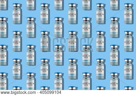 . Vials With Covid-19 Vaccine On Light Blue Background. Vaccination Of Humanity. Fighting The Pandem