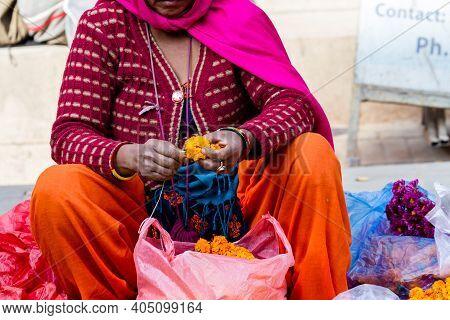 Kathmandu, Nepal - November 17, 2018: Elderly Woman Seller Selling Marigold Flowers For Wreaths At T