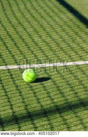Tennis Ball In A Green Tennis Court