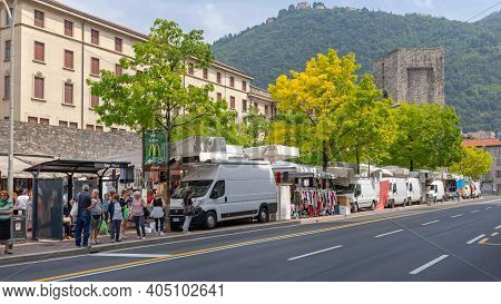 Como, Italy - June 15, 2019: Parked Vans And Trucks At Street Market Saturday In Como, Italy.