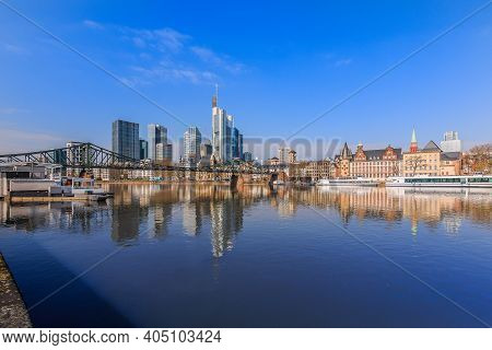 Financial District Of Frankfurt In Sunshine. Skyline Commercial Buildings And Bridge Over The River