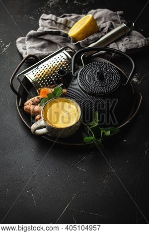 Healthy Warm Herbal Turmeric Tea For Boosting Immune System. Ingredients For Detox Tea In Cup, Black