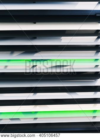 Background With Gray, Green, Black And White Metal Outdoor Jalousie Horizontal Lines