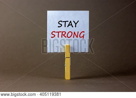 Be Strong Symbol. Wooden Clothespin With White Sheet Of Paper. Text 'be Strong'. Beautiful Grey Back