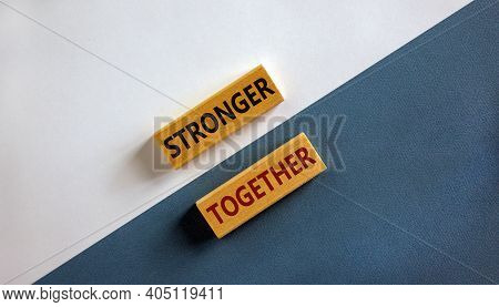 Stronger Together Symbol. Concept Words 'stronger Together' On Wooden Blocks On A Beautiful White An