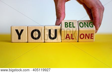 You Alone Or Belong Symbol. Businessman Turns Cubes And Changes Words You Alone To You Belong. Beaut