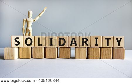 Time To Solidarity Symbol. Concept Word Solidarity On Wooden Cubes On A Beautiful Grey Background. W