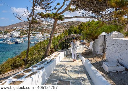 Ios, Greece - September 22, 2020: A Tourist On The Seaside Promenade In Ios Island On A Sunny Day. C