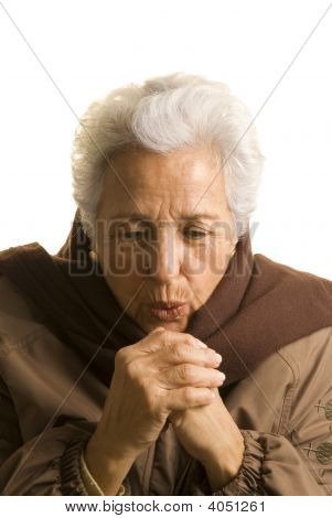 Woman Trying To Keep Her Hands Warm.