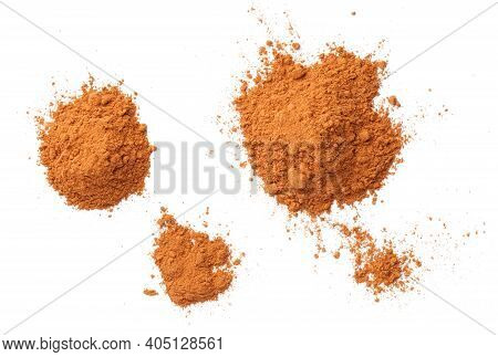 Cinnamon Powder Piles Isolated On White Background, With Shadow. Flat Lay. Top View