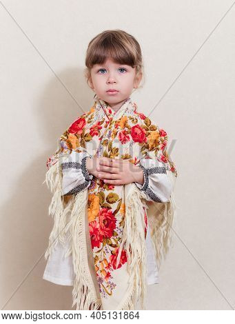Portrait Of Small Pretty Girl In Traditional Ukrainian Style.young Beautiful Girl In A  Long White N