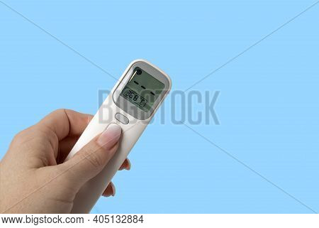 Woman's Hand Holds Thermometer Gun Isometric Medical Digital Non-contact Infrared Sight Handheld For