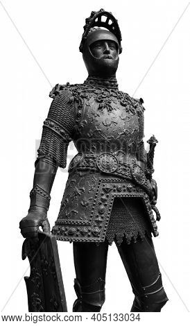 Sculpture of King Arthur old metal statue. Medieval knights armor full size standing warrior. Order of the Knights Templar and an iron knight