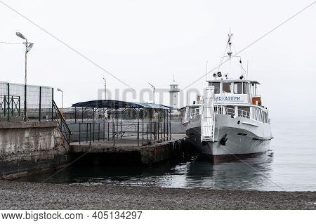 Yalta, Crimea - May 8, 2018: Coastal View Of Yalta Port. Passenger Boat Discovery Is Moored At Quay