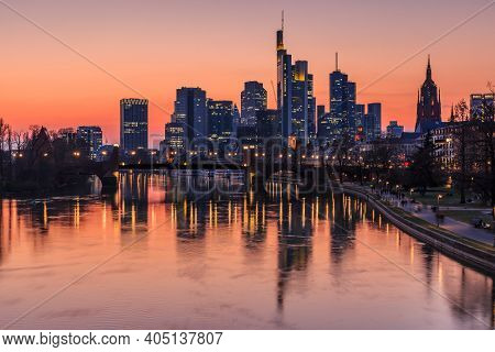 Frankfurt Skyline In The Evening. Commercial Buildings From The Financial District With Lights And R