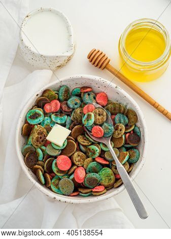 Trendy Food - Pancake Cereal. Heap Of Colorful Mini Cereal Pancakes. Tiny Pancakes With Natural Colo