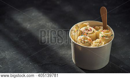 Rolled Ice Cream In Cone Cup On Dark Rustic Background. Vanilla Iced Rolls, Banner. Thai Style Rolle