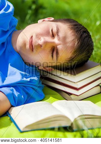 Young Man Sleep With A Book On The Summer Meadow