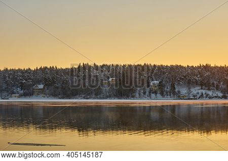 Freezing Sea At Sunset In The Archipelago Near Turku Finland. Copy Space.