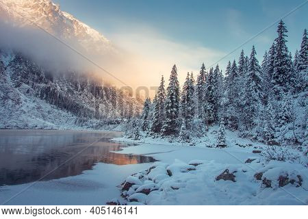 Winter Mountain Landscape In Canada. Wild Snowy Mountain Near An Icy Lake. Pine Forest In Mountains