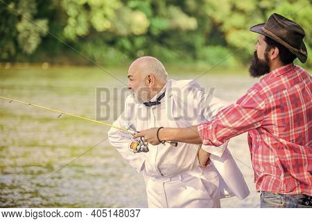 Early Retirement. Hobby And Recreation. Two Fishermen With Fishing Reel. Mature Man Fisher Celebrate
