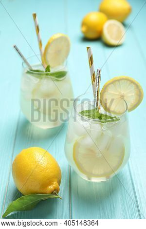 Natural Lemonade With Mint On Light Blue Wooden Table. Summer Refreshing Drink