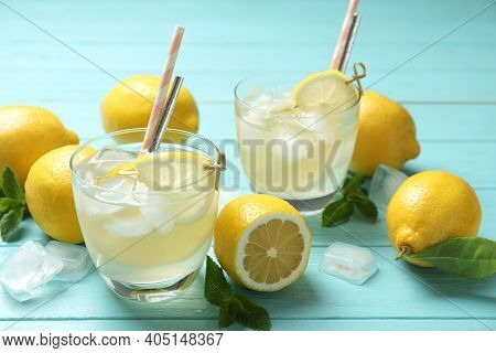 Natural Lemonade And Fresh Fruits On Light Blue Wooden Table. Summer Refreshing Drink