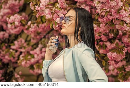 Cherry Blossom Aroma. Fashionable Woman Hold Perfume Bottle. Female Perfume. Spring Perfume. Fancy S