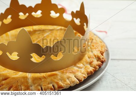 Traditional Galette Des Rois With Paper Crown On White Wooden Table, Closeup