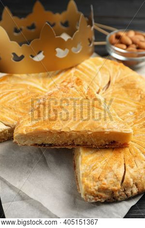 Traditional Galette Des Rois With Paper Crown On Table, Closeup