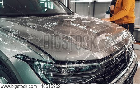 Process Of Installing Of Paint Protection Film Or Ppf On New Car In Professional Auto Detailing Cent