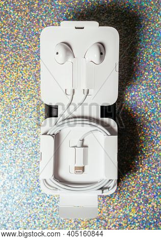 Paris, France - Oct 2, 2018: Brand New Apple Computers Earpods Headphones With Lightning Connector O