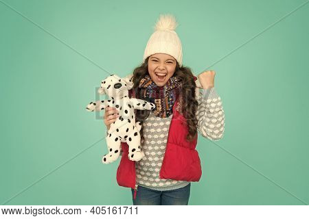 Lovely Baby Smiling Face. Pets Shop. Her Favourite Toy. Happy Child Hold Soft Toy. Little Girl Smile