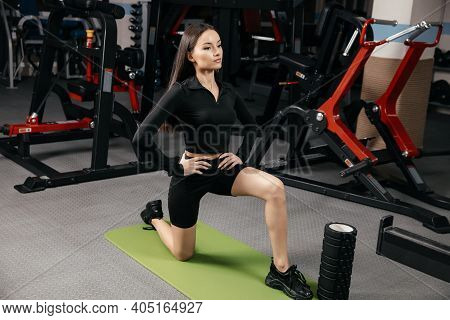 Beautiful White Woman Doing Aerobic Exercise, Warm Up With Gymnastics For Flexibility Leg Stretching